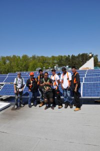 Installing rooftop solar at M'Chigeeng First Nation. 3G trained 10 Band workers on solar system installation. Systems were installed in 2010.